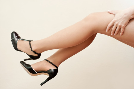 female sexuality: closeup legs of woman with stilettos shoes Stock Photo