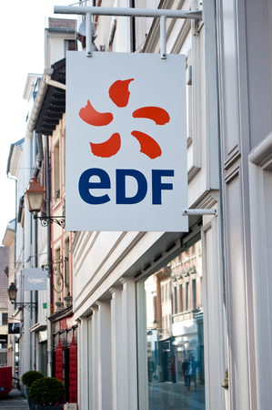 electricity providers: MULHOUSE - France 18 May 2016 - retail of the logo of the brand EDF the french electricity provider signage