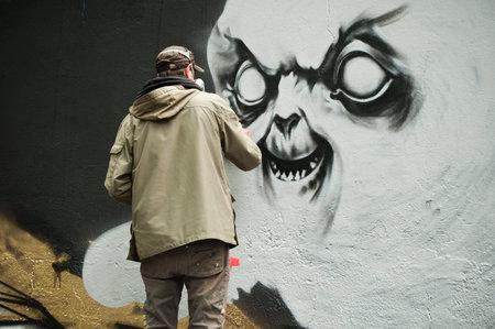 sinners: MULHOUSE - France - 20 June 2016 - painter artist during the BOZAR graffiti festival - quay of sinners in Mulhouse