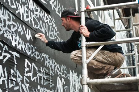 sinners: MULHOUSE - France - 20 June 2016 - painter artist during the BOZAR graffiti festival - quay of sinners in Mulhouse