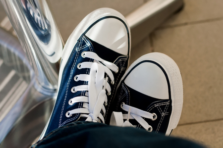 feet with blue summer sneakers