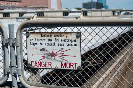 toxic accident: closeup of french panel of danger de mort danger of death at train station