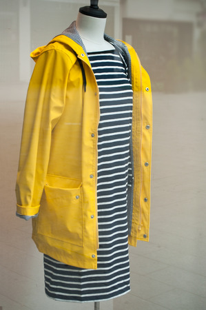 manequin: manequin with yellow raincoat in a shoowroom Stock Photo