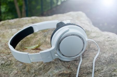 closeup of white headphones in outdoor