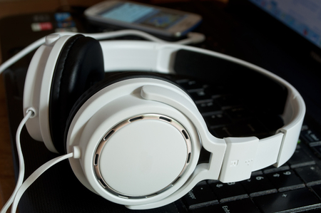 closeup of white headphones on computer Stock Photo