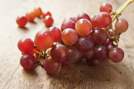 closeup of  black grapes on wooden background