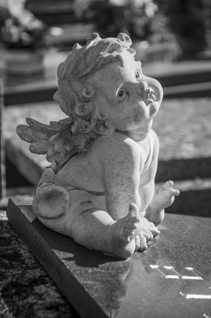 stoned: stoned angel in cemetery on a tomb Stock Photo