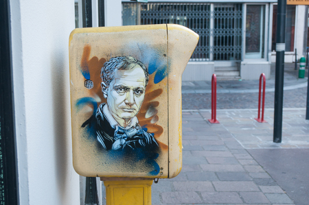 MULHOUSE - France - 3 November 2016 - graffiti of Charles Baudelaire the french writer  on mailbox by the painter artist C215 in Mulhouse.