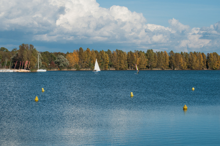 sailboard: panorama of alsatian Lake with sailboard in autumn