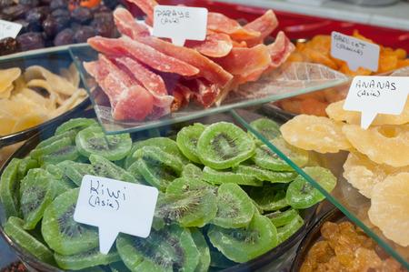 closeup of sliced dried kiwis  and papaya at the market Stock Photo