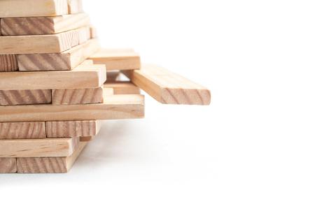 closeup of wooden brick in balance on white background Foto de archivo