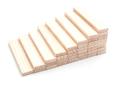 bajando escaleras: closeup of hand try to take off piece of wooden brick of construction game