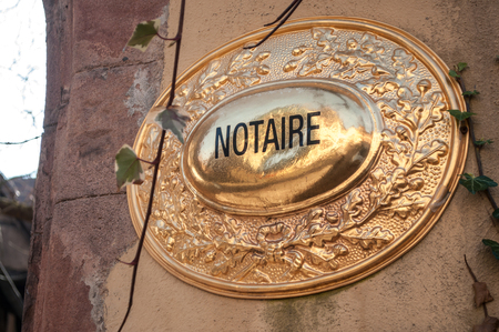 closeup of french notary plate in France - notary ( notaire text in french)  Standard-Bild