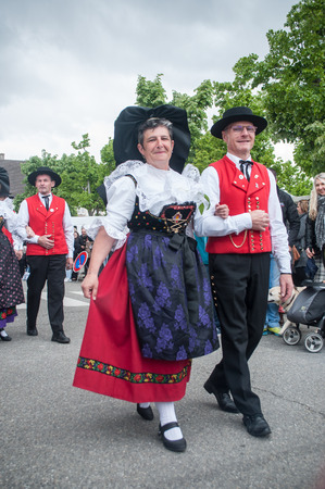 BRISACH - France - 1 May 2017 - traditional alsatian dancers at the lily of the valley party