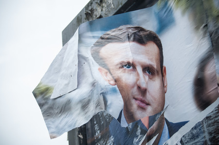 oligarchy: MULHOUSE - France - 24 April 2017 - poster Torn by an angry citizen of the president of en marche Political party Qualified the 23 April 2017 For the second round on 7 May 2017