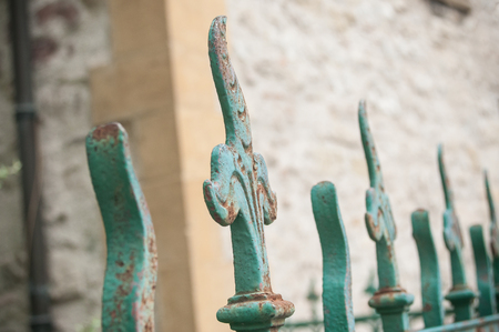 metal grate: closeup of wrought iron gate in front of church