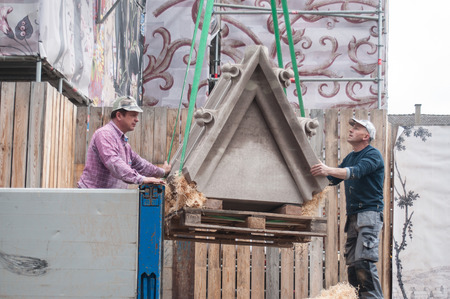 greece granite: MULHOUSE - France - 9 May 2017 - workers  unloading stone carved at the Etienne protestant temple   renovation construction site Editorial