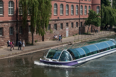 STRASBOURG - France - 25 May 2017 - boat with tourists on  Rhine river at little France quarter in Strasbourg Editorial
