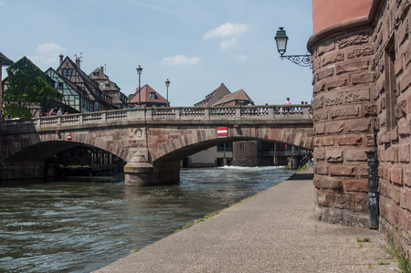 STRASBOURG - France - 25 May 2017 - traditional stoned bridge on IL river at little France quarter in Strasbourg Editorial