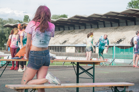 MULHOUSE - France - 4 June 2017 - portrait of teen with short jeans at Colore Mulhouse 2017, the annual running of five kilometers with colored powder jets