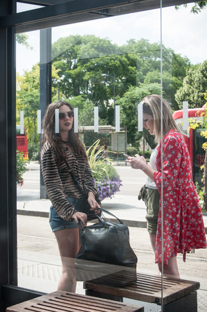 MULHOUSE - France - 12 June 2017 -  teenagers waiting at the bus stop near the train station in Mulhouse