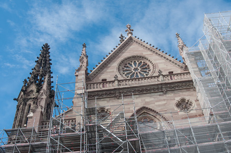 MULHOUSE - France - 29 June 2017 - Dismantling the scaffolding after the renovation of the facade of the temple st Etienne