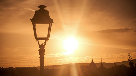 closeup of lamppost on sunset landscape background Stock Photo
