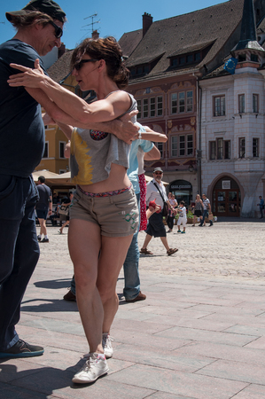 MULHOUSE - France - 10 June 2017 - couples of tango dancers on main place with other dancers at the spring tango festival