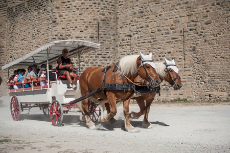 Carcassonne - France - 21 August 2017 - carriage with tourists around the fortifications