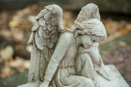 closeup of stoned angel in cemetery Stock Photo