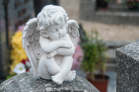 closeup of stoned angel at cemetery Stock Photo