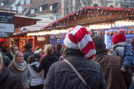 Mulhouse - France - 26 Movember 2017 - people walking at christmas market with christmas hat