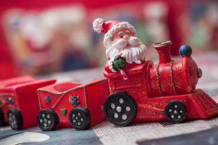 closeup of santa claus on miniature toy train Stock Photo
