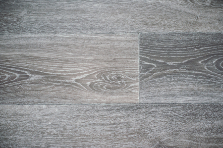 灰色のリノリウムの背景の木製の質感のクローズアップ