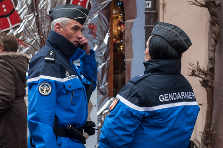 Riquewihr - France - 16 December 2017 - Gendarme patrolling with phone at the christmas market