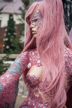 Portrait of costumed mannequin at elf fantasy style for Christmas market decoration