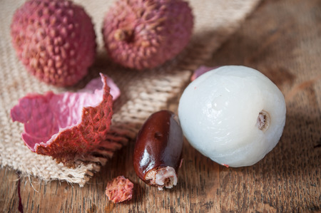 Closeup of lychees on wooden table background