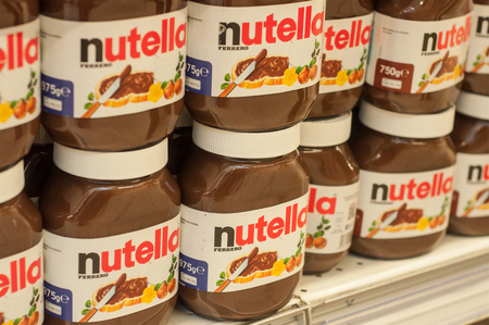 Mulhouse -  France - 2nd February  2018 : Display Nutella chocolate hazelnut spread with cocoa on the shelf in Cora supermarket