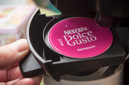 Mulhouse - France - 8 February 2018 - closeup of Nescafe expresso, the french brand of coffee dose in hand