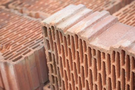 closeup of terra cotta bricks pile in construction site