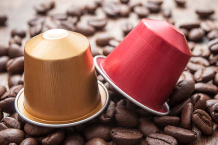 closeup of colorful espresso coffee doses with coffee beans  on wooden table background