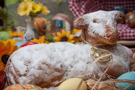 closeup of Easter lamb in cake with icing sugar with easter decoration
