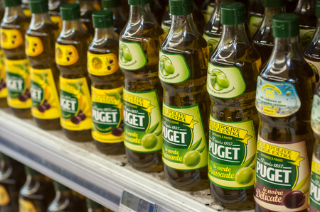 Mulhouse - France - 26 February 2018 -closeup of olive oil bottles alignment from Puget Brand at Cora Supermarket