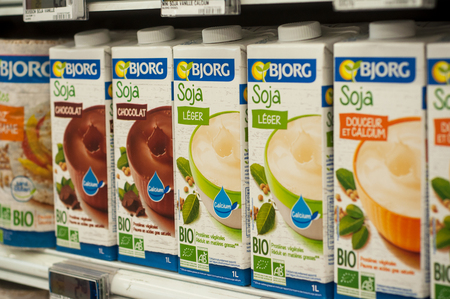 Mulhouse - France - 26 February 2018 -closeup of bottles of organic soy milk from Bjorg brand at Cora Supermarket Editorial