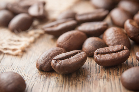closeup of coffee beans on wooden table background