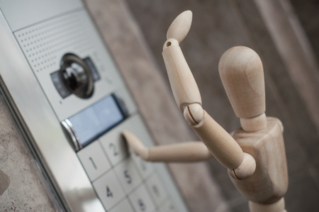 closeup of wooden puppet and inerphone with camera - concept security