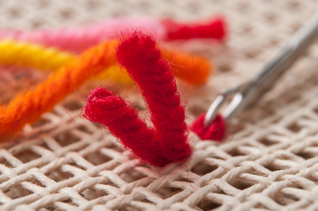 closeup of creative leisure with colorful wool wire on canvas
