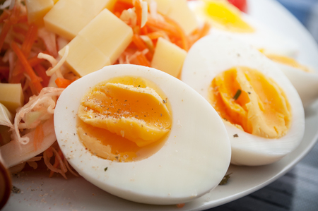 closeup of hard boiled eggs with vegetables in a plate Stock Photo