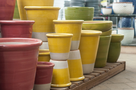 closeup of colorful ceramic pots in a gardening store