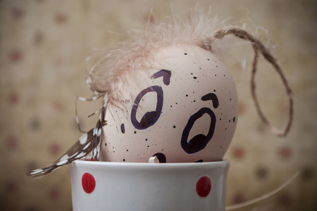 Closeup of funny Easter eggs with expressive face drawing Stock Photo